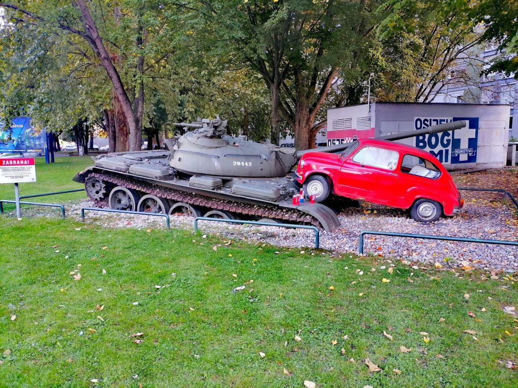 Red car running over tank in Osijek, Croatia