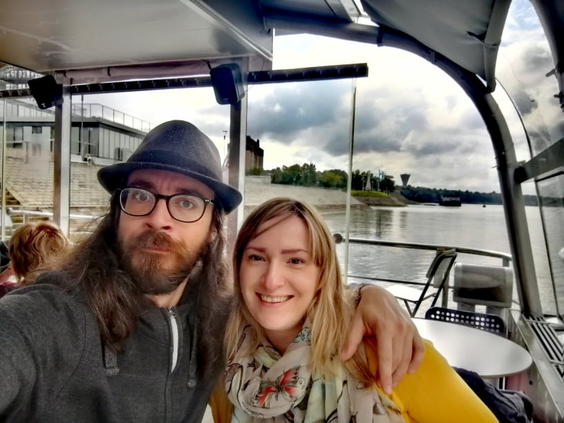 Husband and wife on a boat on Danube river, Croatia